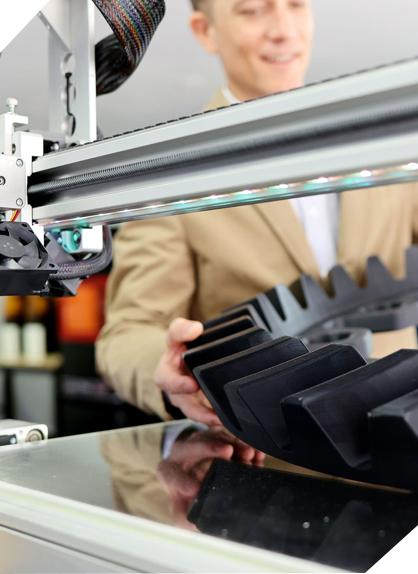 Man using 3D printer to print part